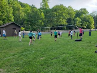 Conservation Officers and Game Managers in a competitive game of volleyball.